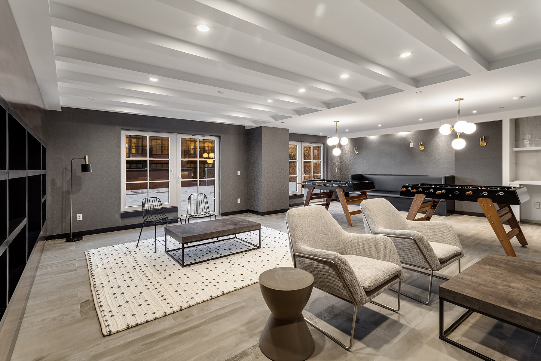 Common Lounge Area In Brooklyn Luxury Apartment Building Featuring Foosball Tables And Couches