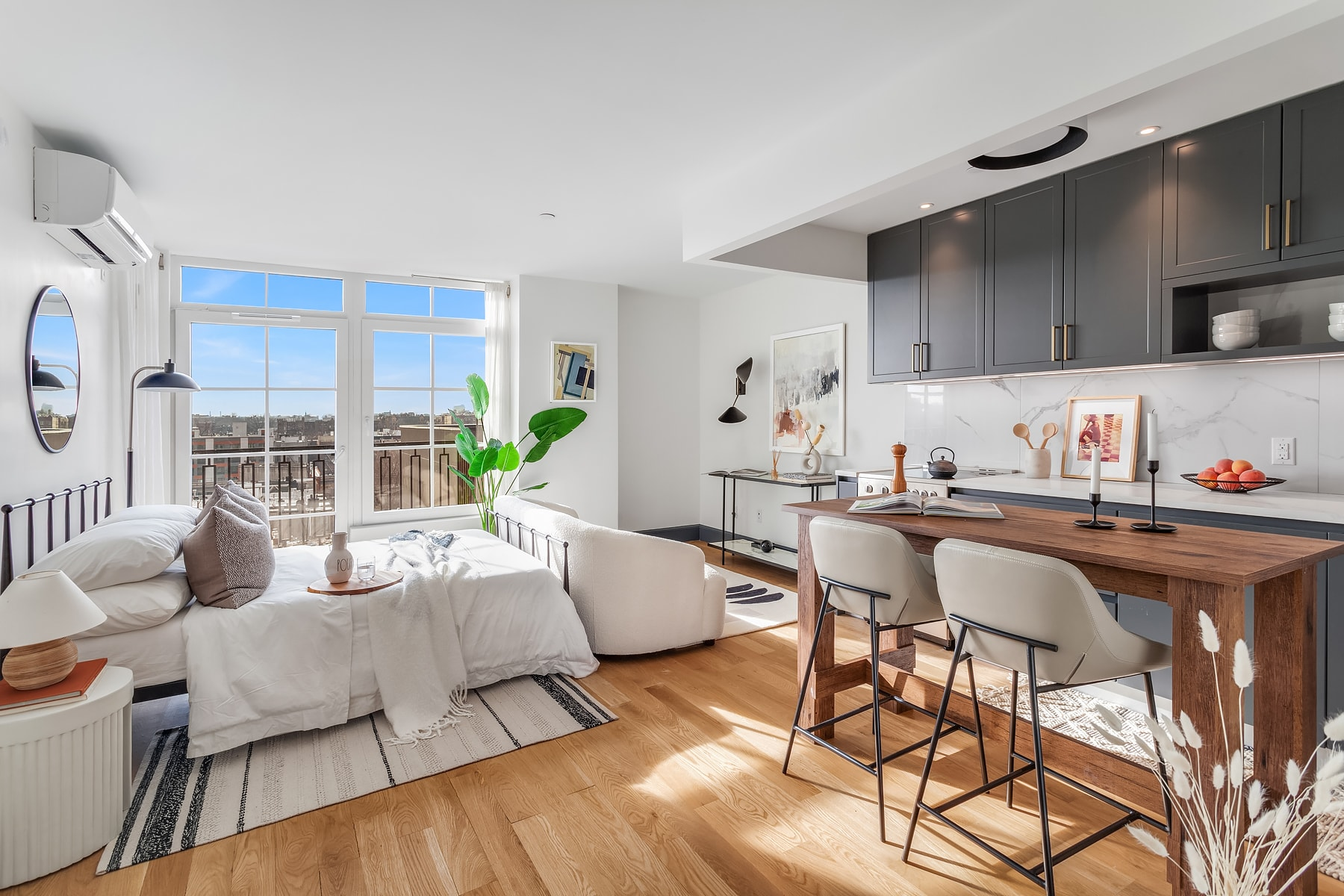 Large Brooklyn Studio Apartment For Rent in Bed-Stuy Neighborhood With French Windows and City Views